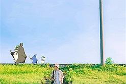 Xốn xang trước triền cỏ xanh mướt ở đê Ngọc Thụy Hà Nội đẹp tựa những thước phim anime Nhật Bản