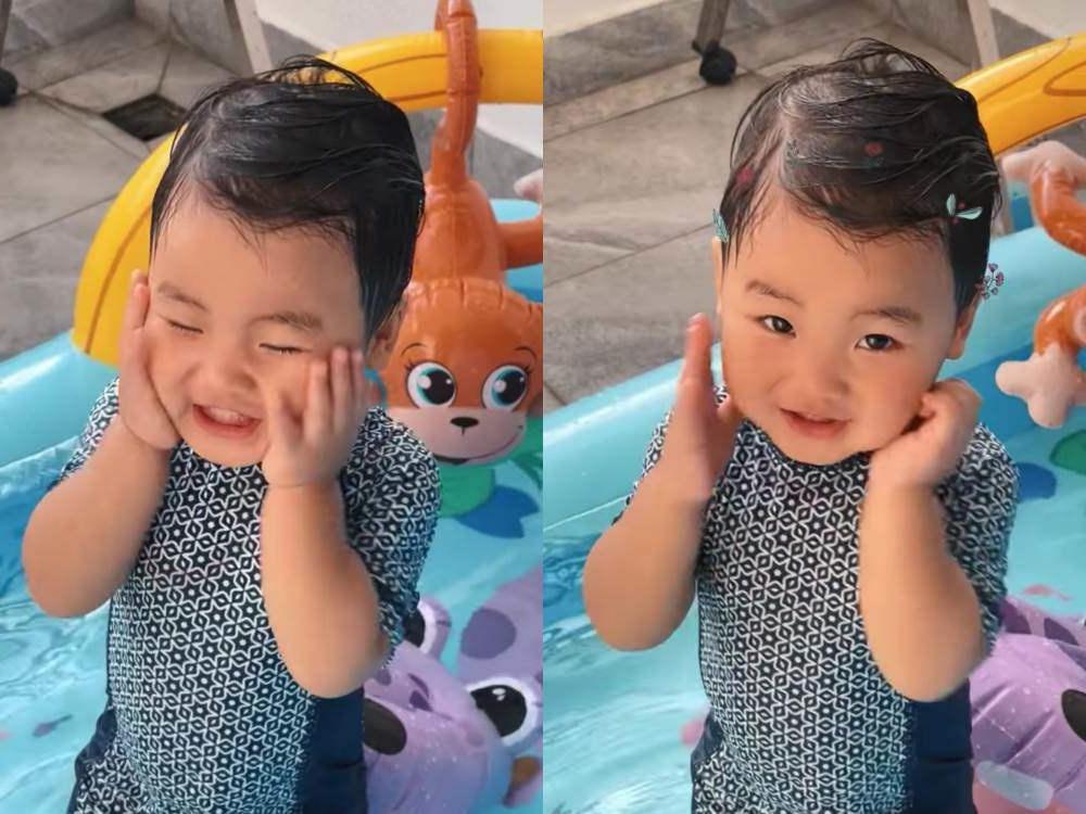 con sao Việt đi bơi cùng bố mẹ