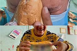 Người phụ nữ đi đường xa đến nhận đồ từ thiện mà chỉ có... 2 ổ bánh mì nhưng lại òa khóc khi thấy phần nhân bên trong